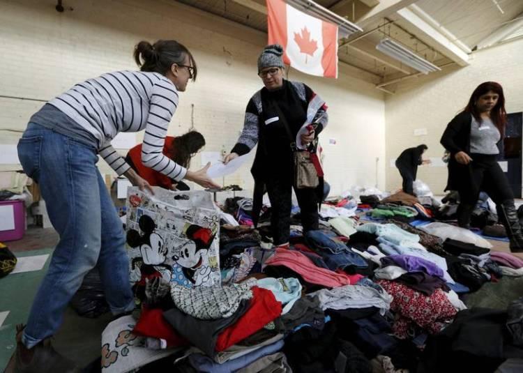 Refugee clothing sorting.jpg